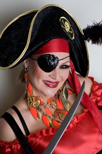 A photo of a woman wearing a pirate costume